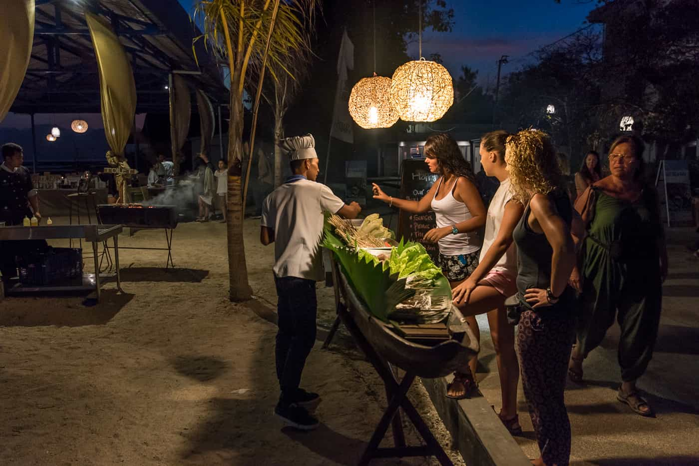 Sunset beach barbeque at Hotel Ombak Paradise in the Gili Islands of Lombok Indonesia